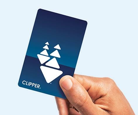 A hand holding a clipper card