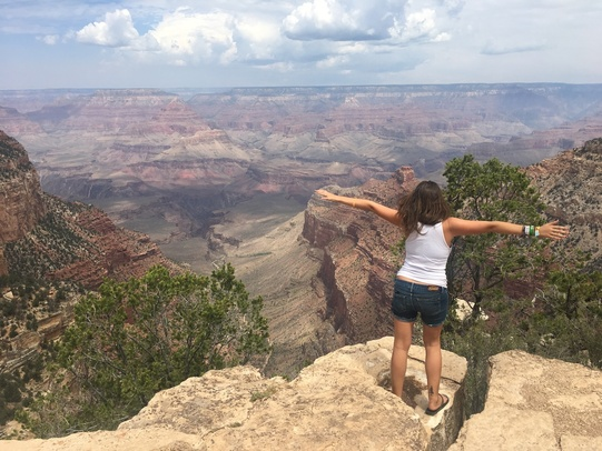 girl stands in front of the Grand Canyon