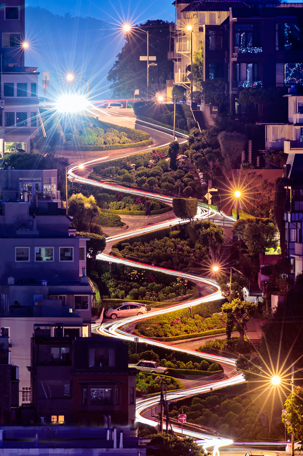 A time lapse photo of Lombard Street at night