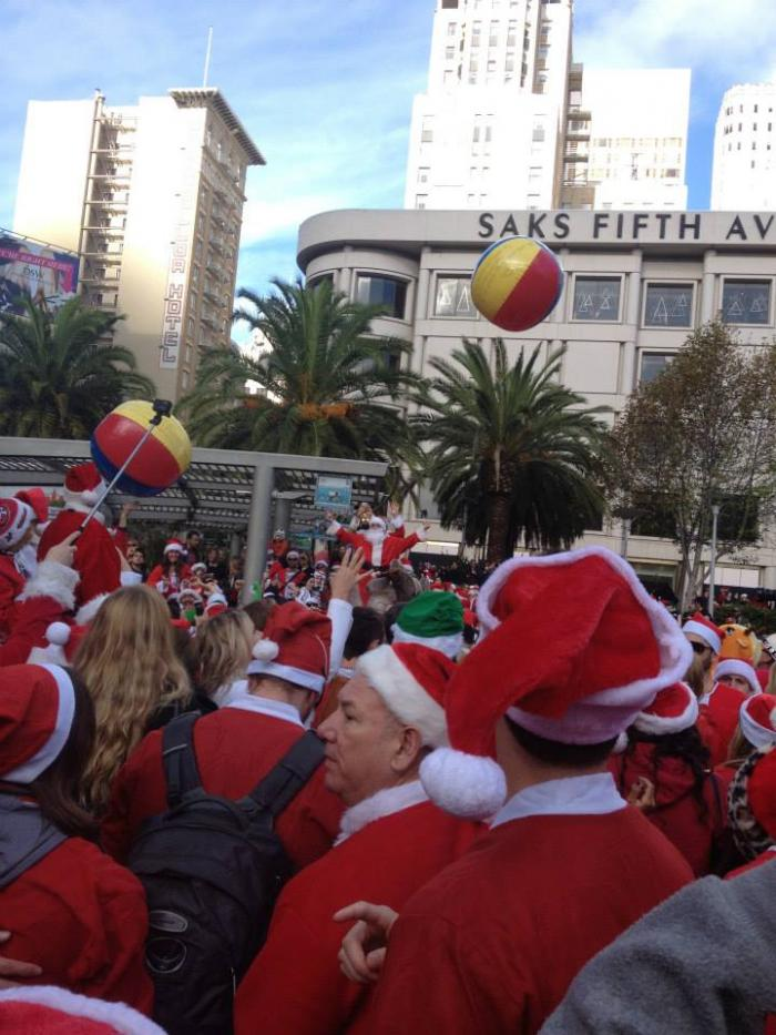 People dressed in Santa suits celebrate SantaCon 2014 in Union Square in San Francisco.